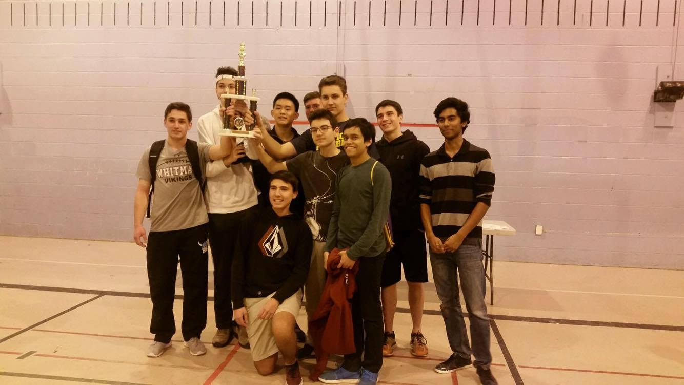 The chess team holds up their first place trophy at the Maryland State Chess Championship. Photo courtesy Alex Chen.