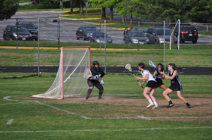 Attacker Eden Gray finds the back of the net to extend the Vikings' lead. The team defeated Einstein in a crushing victory to advance to an 11-2 record. Photo courtesy Julia Curran.