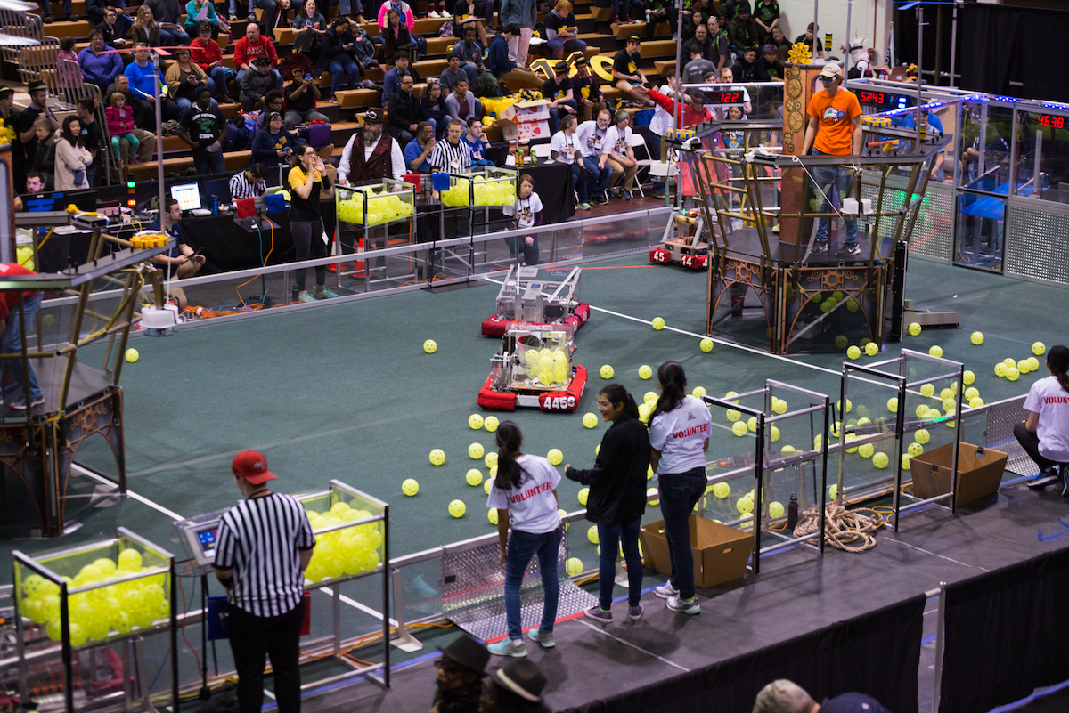 Robots+compete+to+score+points+at+a+robotics+district+event++March+25+as+spectators+cheer+them+on.+Whitman%E2%80%99s+team%2C+The+Body+Electric%2C+took+first+place%2C+marking+a+team+milestone.+Photo+by+Jefferson+Luo.