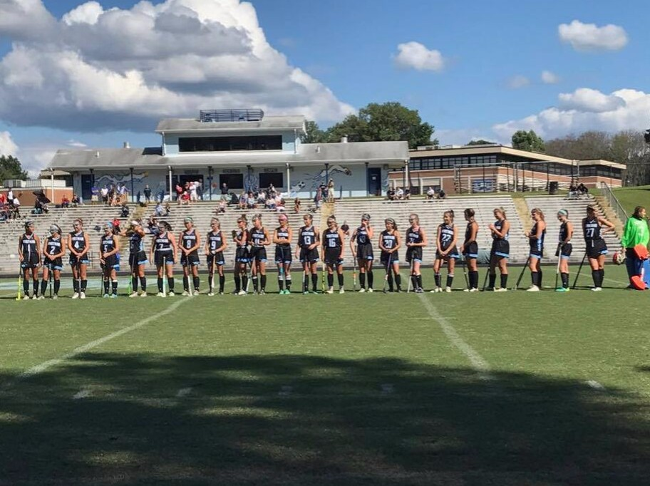 The+team+lines+up+before+the+game+for+the+national+anthem.+The+girls+dominated+the+game%2C+keeping+a+clean+sheet+and+bagging+4+goals.+Photo+by+Meg+Jones.+