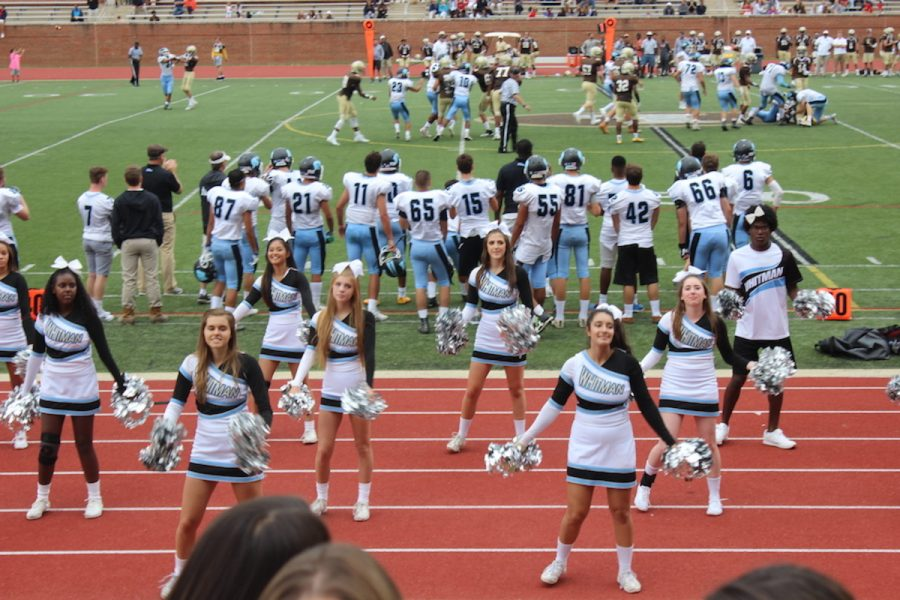 Football players watch their teammates on the field. The Vikes lost their season opener 34-0 to the Landon Bears, a slow start to their season. Photo courtesy Cami Corcoran.