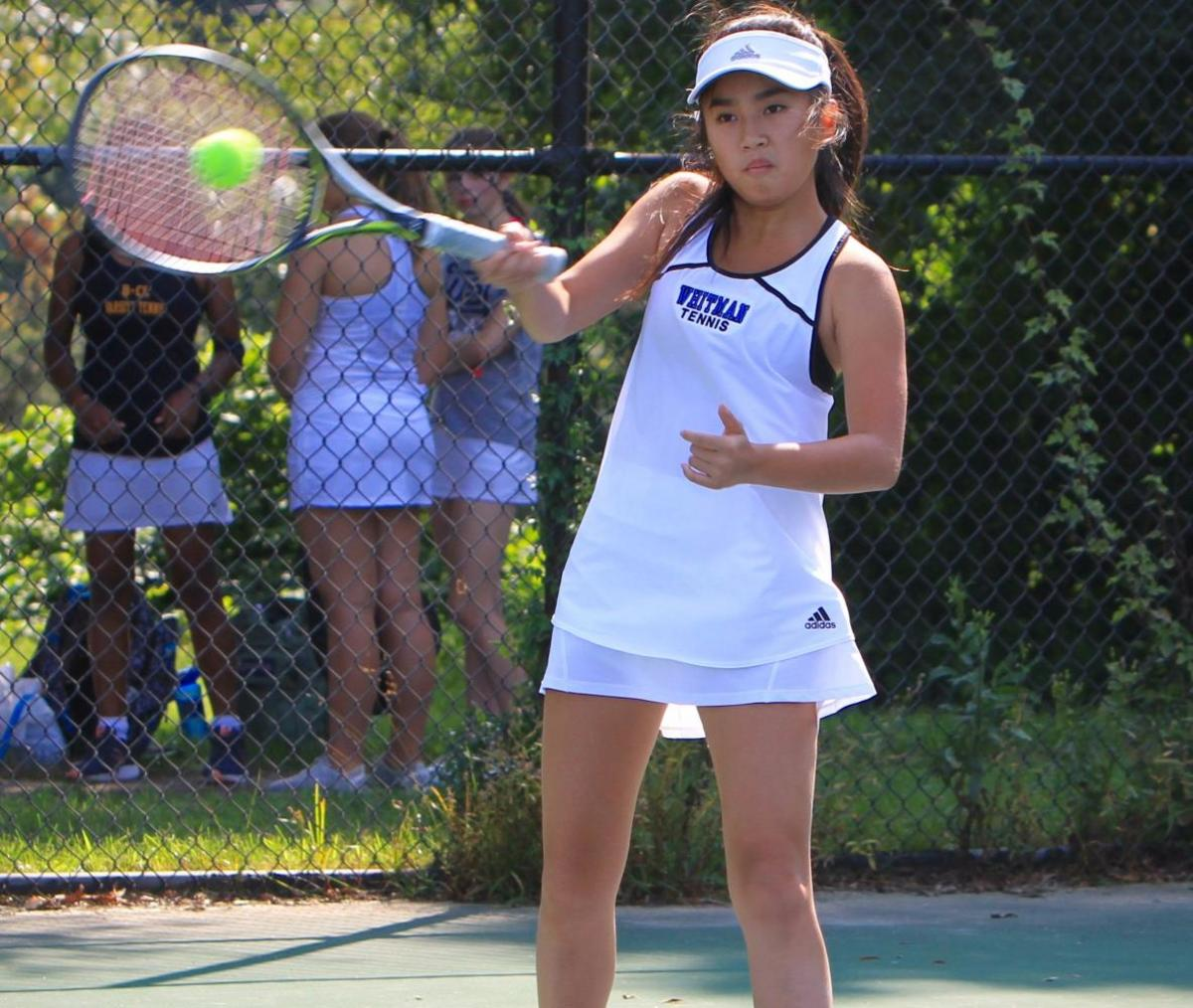 Tennis players push forward despite a forfeit due to injury. The tennis team lost a close match to Wootton. Photo by Olivia Matthews.