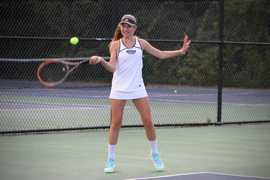 A+Whitman+tennis+player+returns+a+point.+The+girls+tennis+team%2C+though+losing+a+tough+match+to+WJ+by+default%2C+beat+Northwest+and+Clarksburg.+Photo+by+Olivia+Matthews.+
