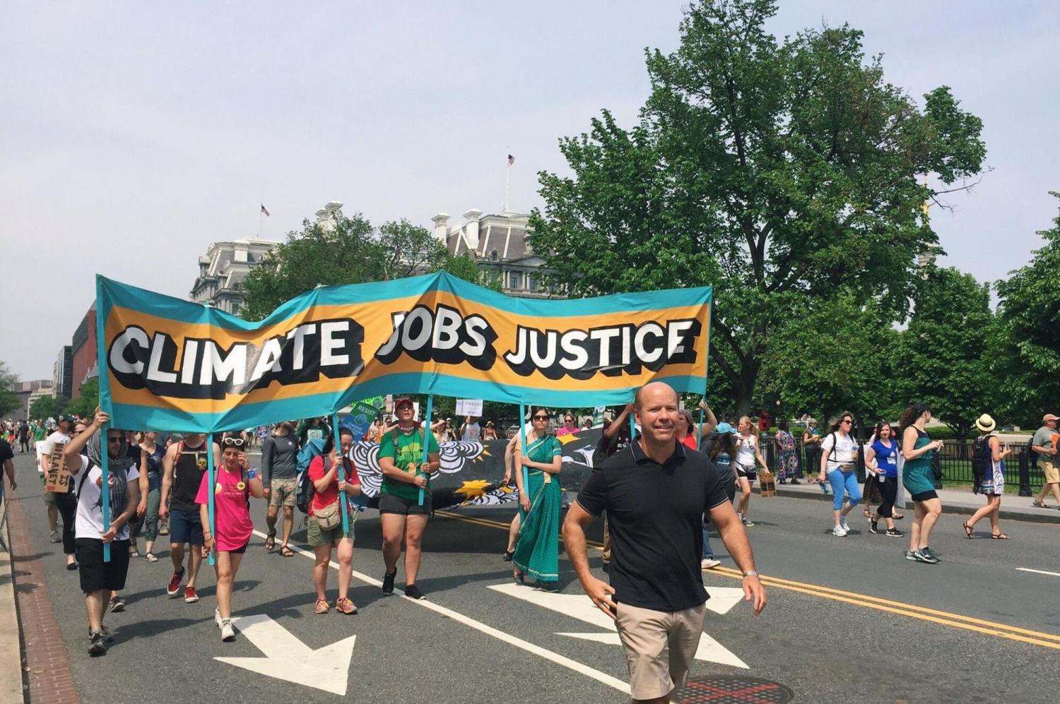 Congressman John Delaney marches with supporters at the Climate March. Delaney became the first official candidate of the 2020 presidential election on July 28. Photo courtesy Delaney campaign.