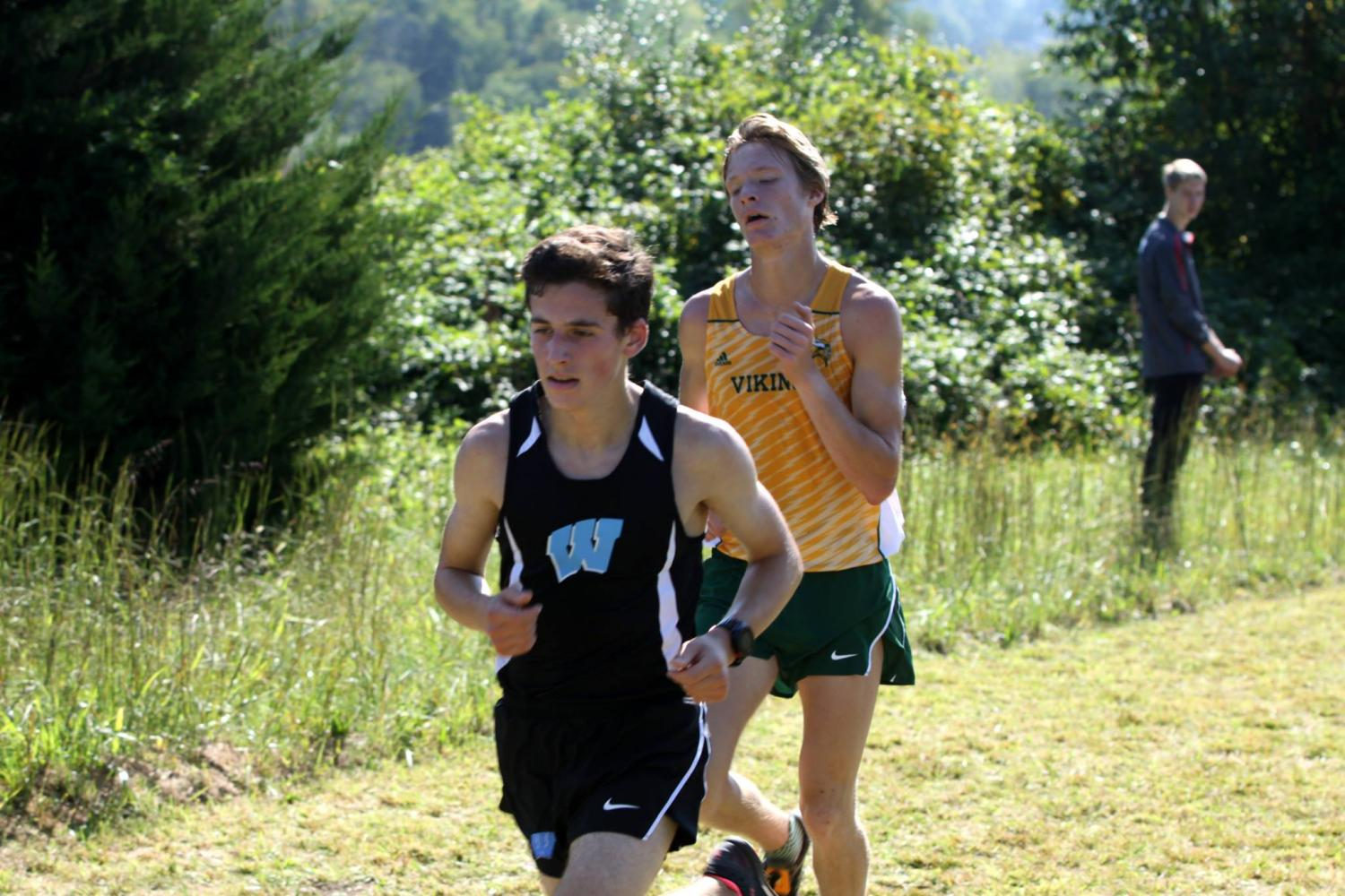 junior Aaron Bratt sprints his way to a second place finish. Photo courtesy of Mocorunning