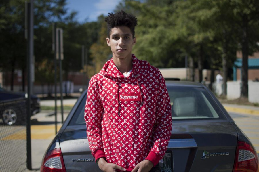 Senior+Aldo+Ninassi+wears+his+Supreme+X+Louis+Vuitton+hoodie.+Many+Whitman+students+have+started+to+invest+in+expensive%2C+name+brand+clothing+as+part+of+a+%22hype-beast%22+culture.+Photo+by+Annabelle+Gordon.