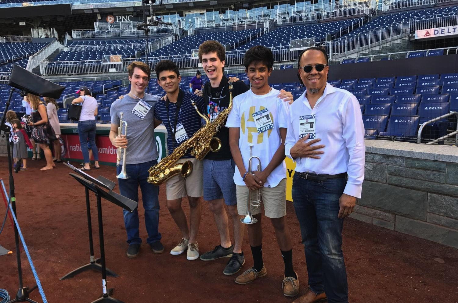 Seniors Patrick Wright (far left) and Ethan Dodd (center) played the national anthem at the Nationals game Sept. 28 in a quartet. Blues Alley Youth Orchestra and director Michael Bowie (far right) organized the jazz arrangement. Photo courtesy Patrick Wright.