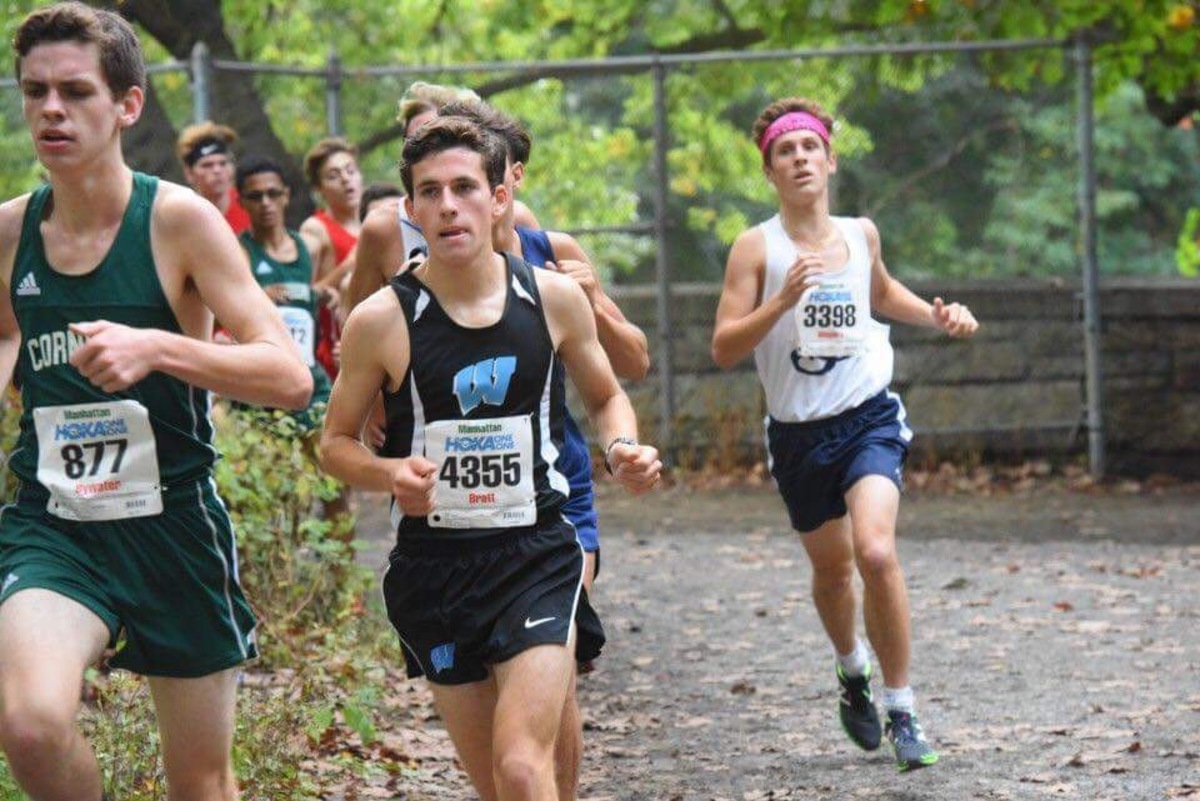Junior Aaron Bratt rounds a curve in a race. Bratt, along with the rest of the cross country and treack and field teams, follow pre-set runs that are simple and vary in difficulty and length. Photo courtesy MileSplit.