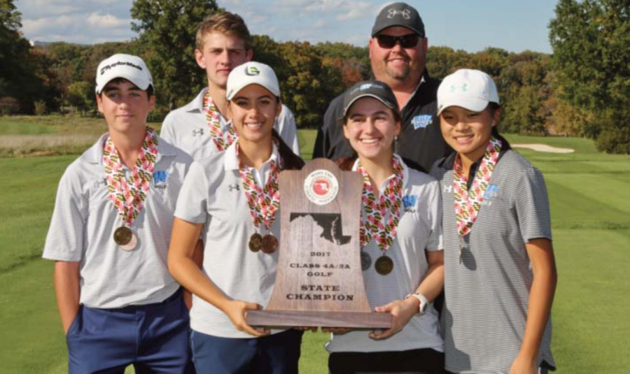 Golfers+pose+with+their+trophy.+The+team+beat+Churchill+to+win+the+state+championship+Oct.+25.+Photo+courtesy+MPSSAA.