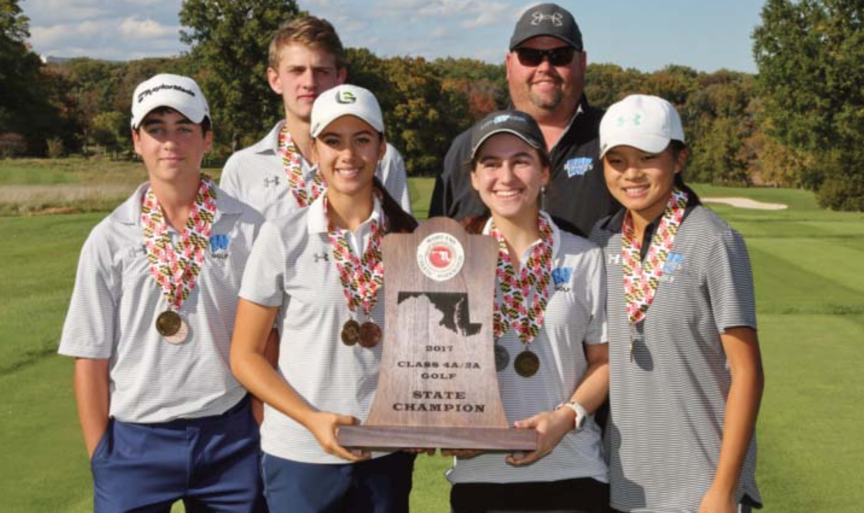 Golfers pose with their trophy. The team beat Churchill to win the state championship Oct. 25. Photo courtesy MPSSAA.
