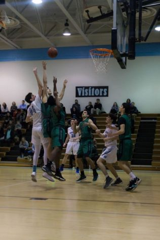 Boys basketball takes out Walter Johnson; wins 67‒56