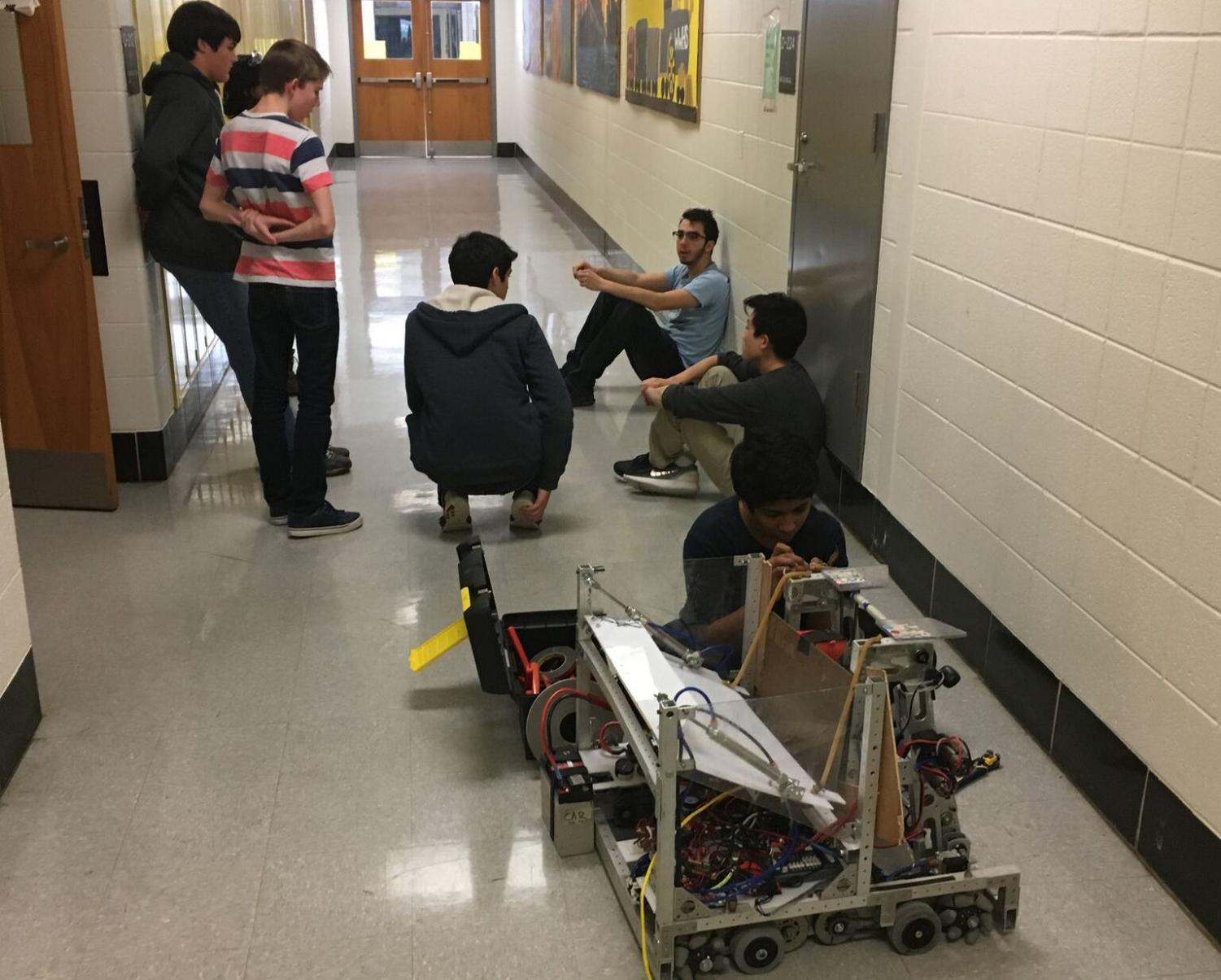 Members of the Body Electric meet and plan their robot for the FIRST competition in March. With a large group of freshmen this year, the team now has many new members to help across their mechanical, electrical and programming sub-teams. Photo by Naren Roy.