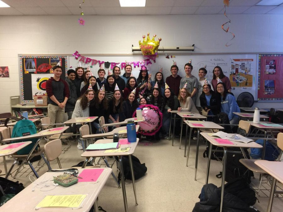 AP Spanish students pose with their teacher, Fabiola Katz, in front of the decorations they put up for her surprise birthday party.  Students set up the party and made a video for Katz. Photo courtesy Fabiola Katz.