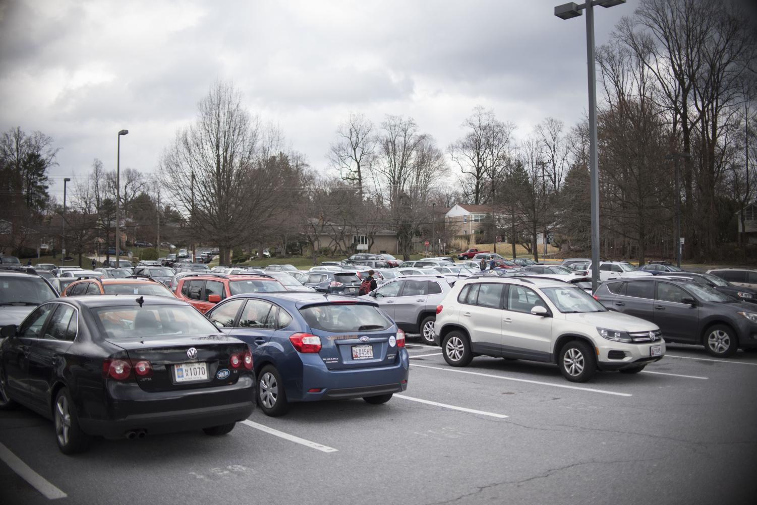 Cars sit parked in the Whitman parking lot. The lot is the scene of a minor accident on a near daily basis. Photo by Annabelle Gordon.