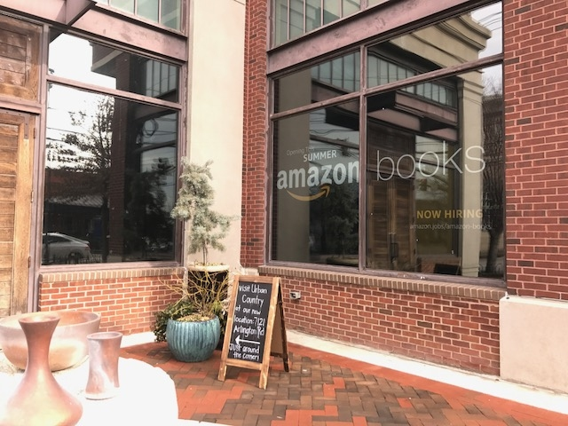An Amazon Books Sign Hangs In The Window Of Urban Country. The Store Will  Open
