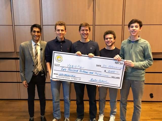 Students+stand+with+thier+prize+money.+Four+students+won+the+Social+Entrepreneurship+Tournament+Feb.+24-25+with+their+business+pitch+for+VegiCity%2C+a+company+that+would+help+families+grow+their+own+fresh+produce.+Photo+courtesy+Alex+Manes.