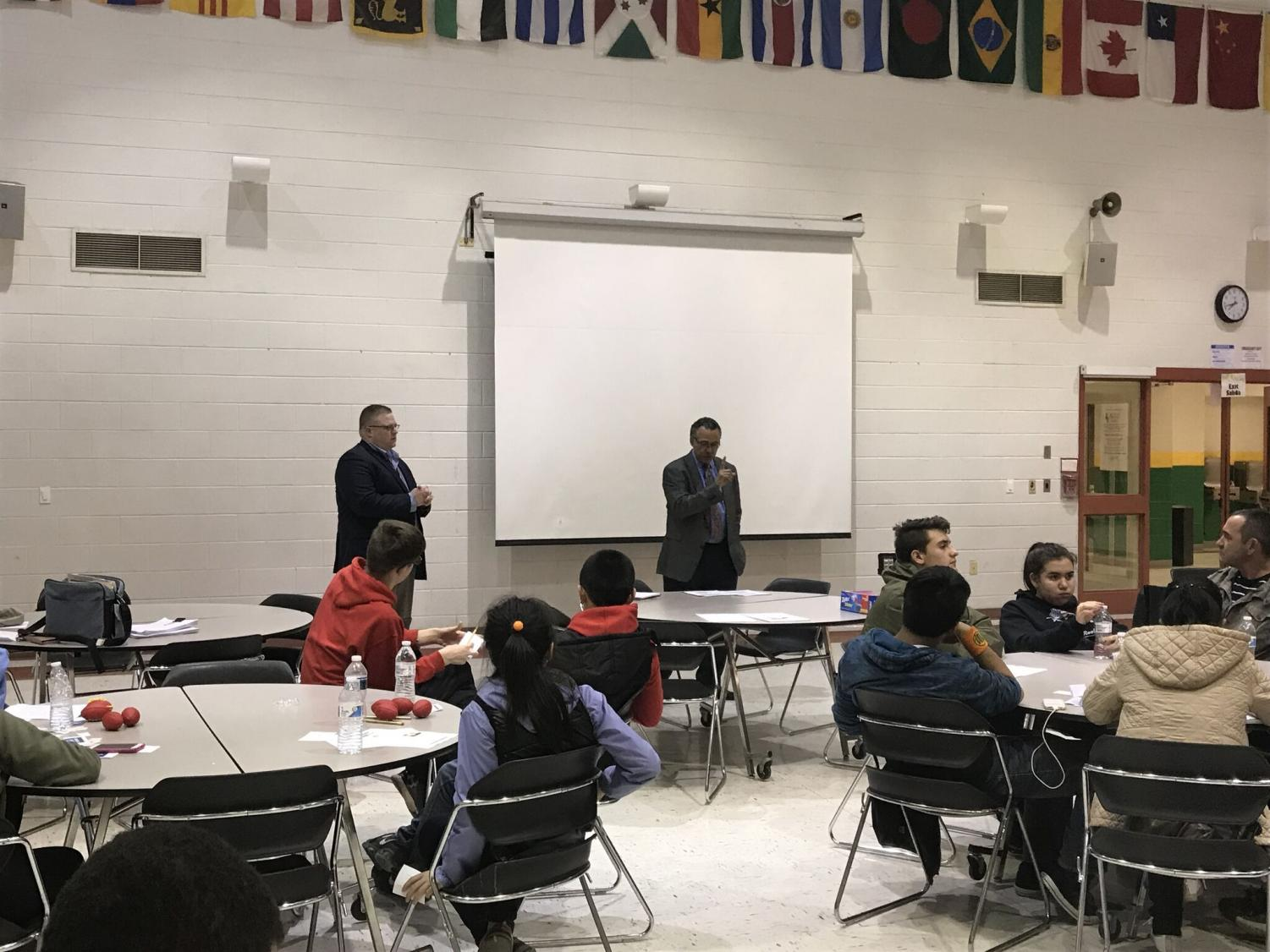 Elias Stoddard (right) and Raymond Crowel (left) answer questions during a Q&A at the Feb. 26 Montgomery County Save a Life Opioid Forum. They provided important facts about the extent of the opioid crisis, such as the fact that deaths due to opioid overdose doubled in the county from 2015 to 2016, and have continued to rise throughout 2017. Photo by Sydney Miler.