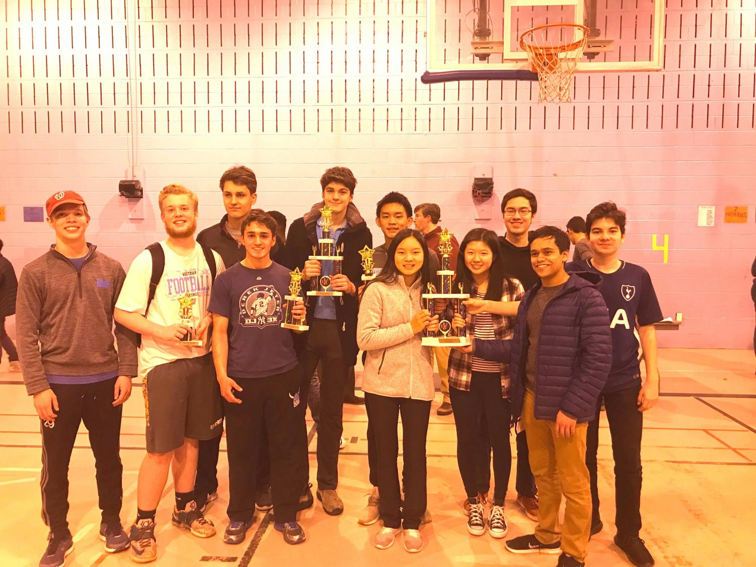 Whitman chess team members hold up group and individual trophies after winning the state championship March 17.  The victory marked the Vikings' second consecutive state championship. Photo courtesy Alex Chen.