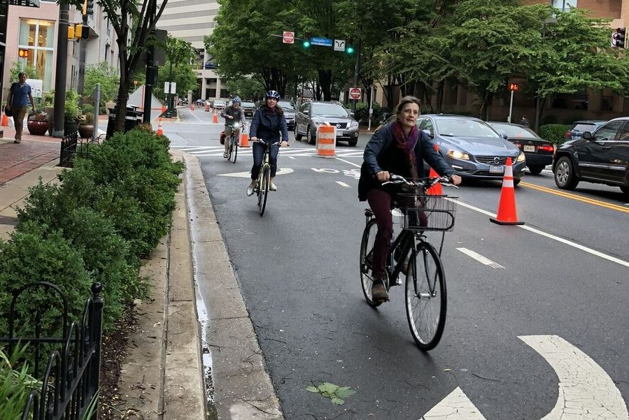 A+biker+uses+the+temporary+lane+set+up+in+Downtown+Bethesda.+The+pop-up+lane+was+part+of+an+initiative+by+the+Montgomery+County+Department+of+Transportation+to+create+more+safe+biking+infrastructure.+Photo+by+Zara++Ali.+