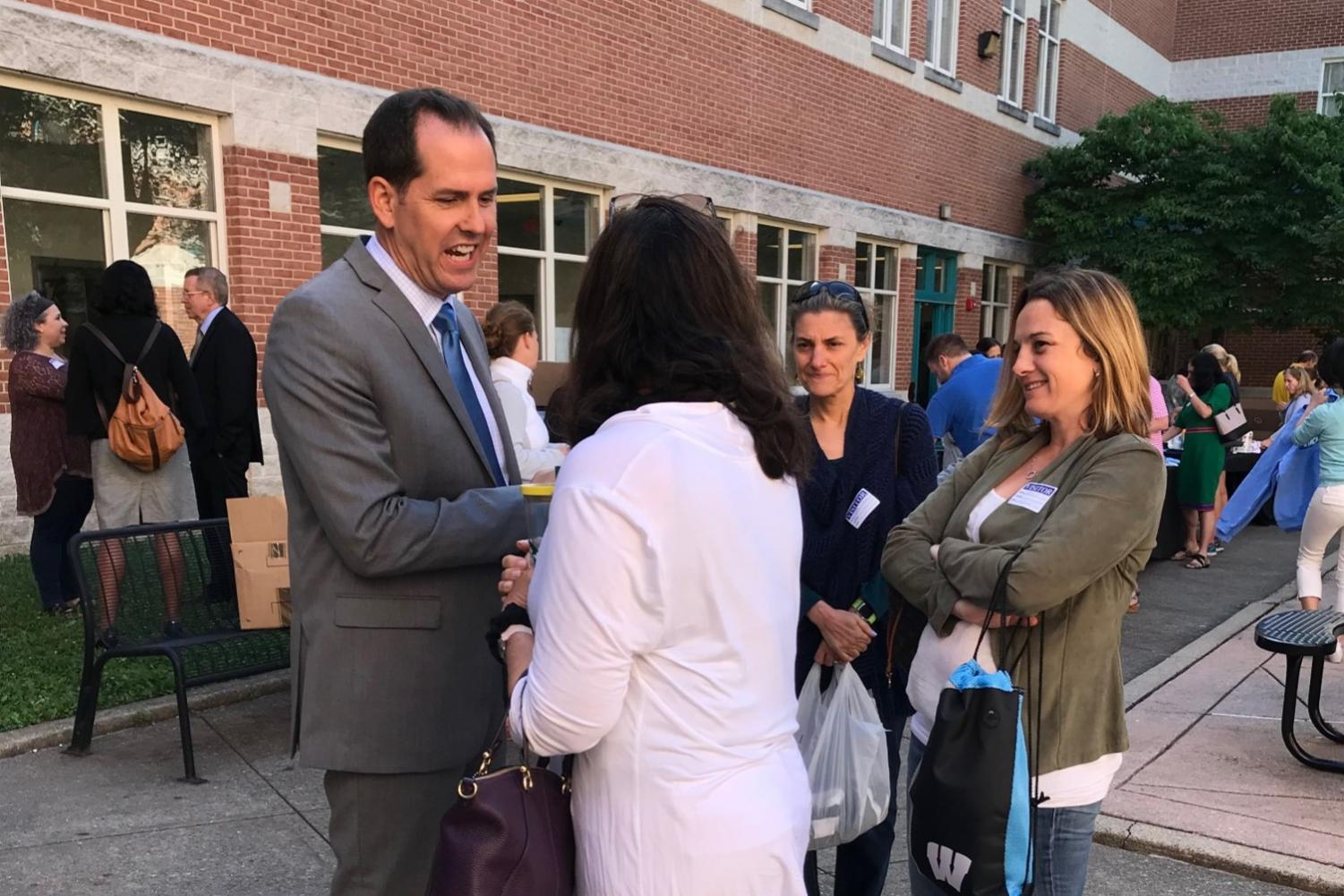 Incoming principal Robert Dodd talks to parents at the annual principal's coffee for new parents June 12. Dodd will host three more coffees this summer open to all parents. Photo courtesy of Elizabeth Drye.