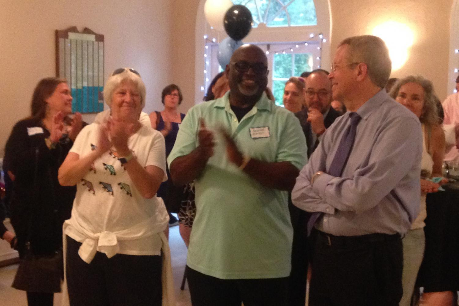 Departing principal Alan Goodwin and departing assistant principals Kathy McHale and Jerome Easton enjoy their retirement party, held by the PTSA June 13. The event was open to staff members, parents and former students. Photo by Pam Toole.