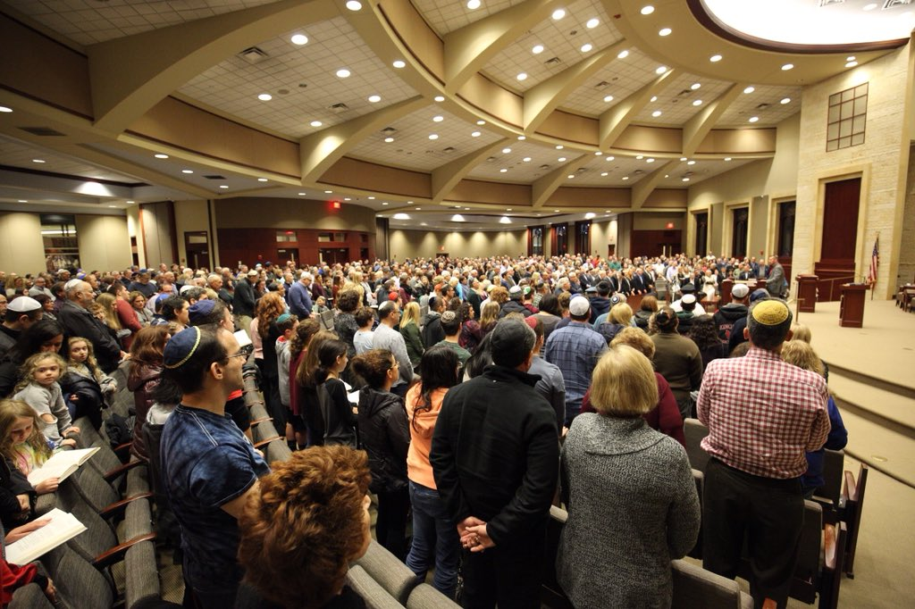More than 1,200 people attend an interfaith vigil in honor of the victims of the shooting at the Tree of Life Synagogue in Pittsburgh. Similar vigils were held across the country in the wake of the tragedy.