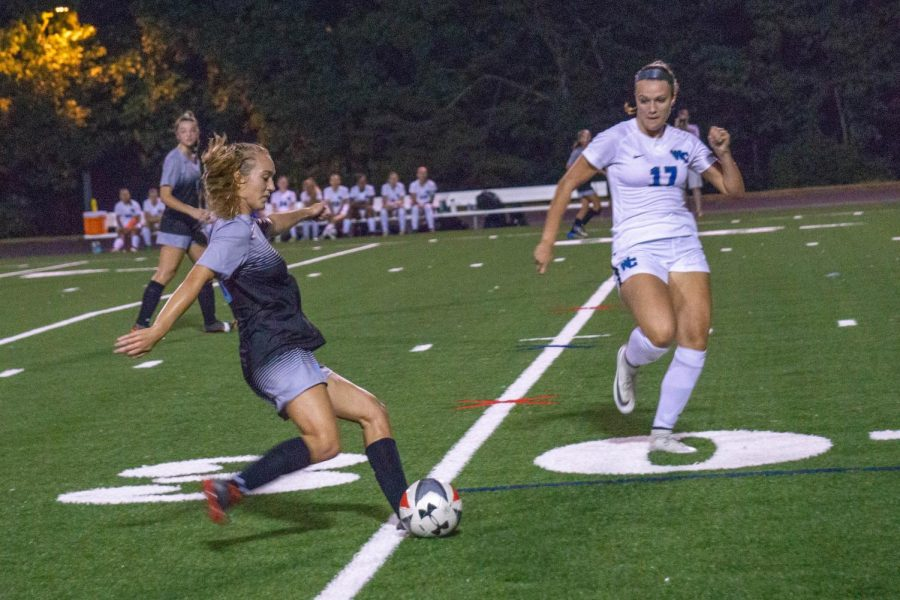 Defender Sophie Nichols sends the ball to her teammate down the field. The team looks to continue their winning streak as they approach the end of the regular season. Photo by Lukas Gates.