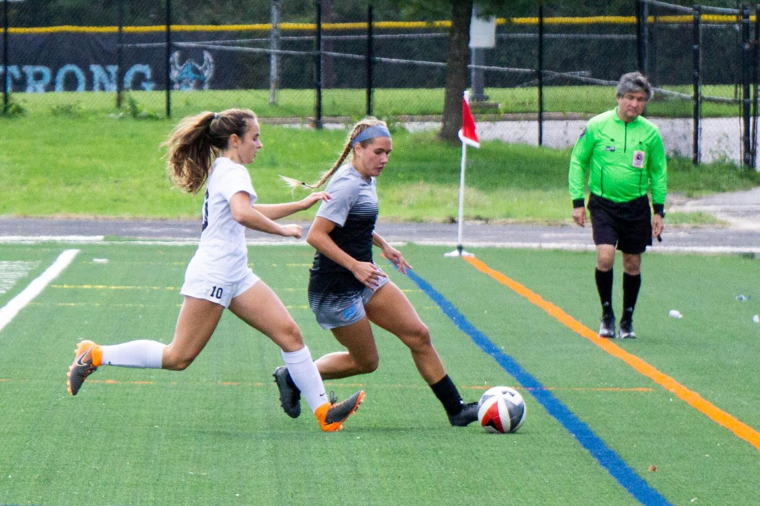 Forward Isabella Bravo cuts past a B–CC defender. The team defeated the Barons in the Battle of Bethesda, a key win as they near playoffs. Photo by Lukas Gates.