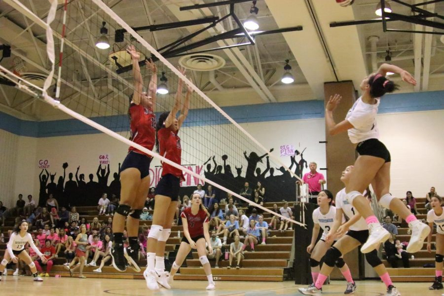 Outside hitter Bella Pardo jumps to spike the ball against the Wootton Patriots. This game was the team's annual Dig Pink fundraiser to raise money for the fight against breast cancer. Photo by Defne Aslan