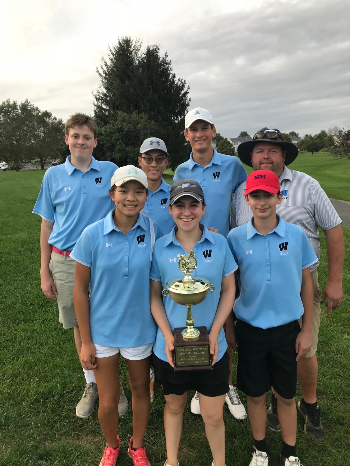 Senior Amanda Levy holds the Bethesda Cup Trophy, surrounded by her teammates. The team placed first in the Competition October 10. Photo courtesy Amanda Levy.