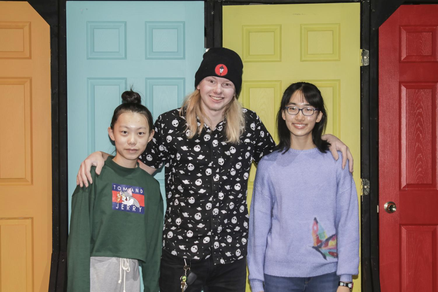 The general team, which has many members absent from the photo, is in charge of construction and builds the set. From left to right: freshman Yi Jing, senior Tucker Sutcliffe and freshman Betty Zhu. Photo by Sam White.