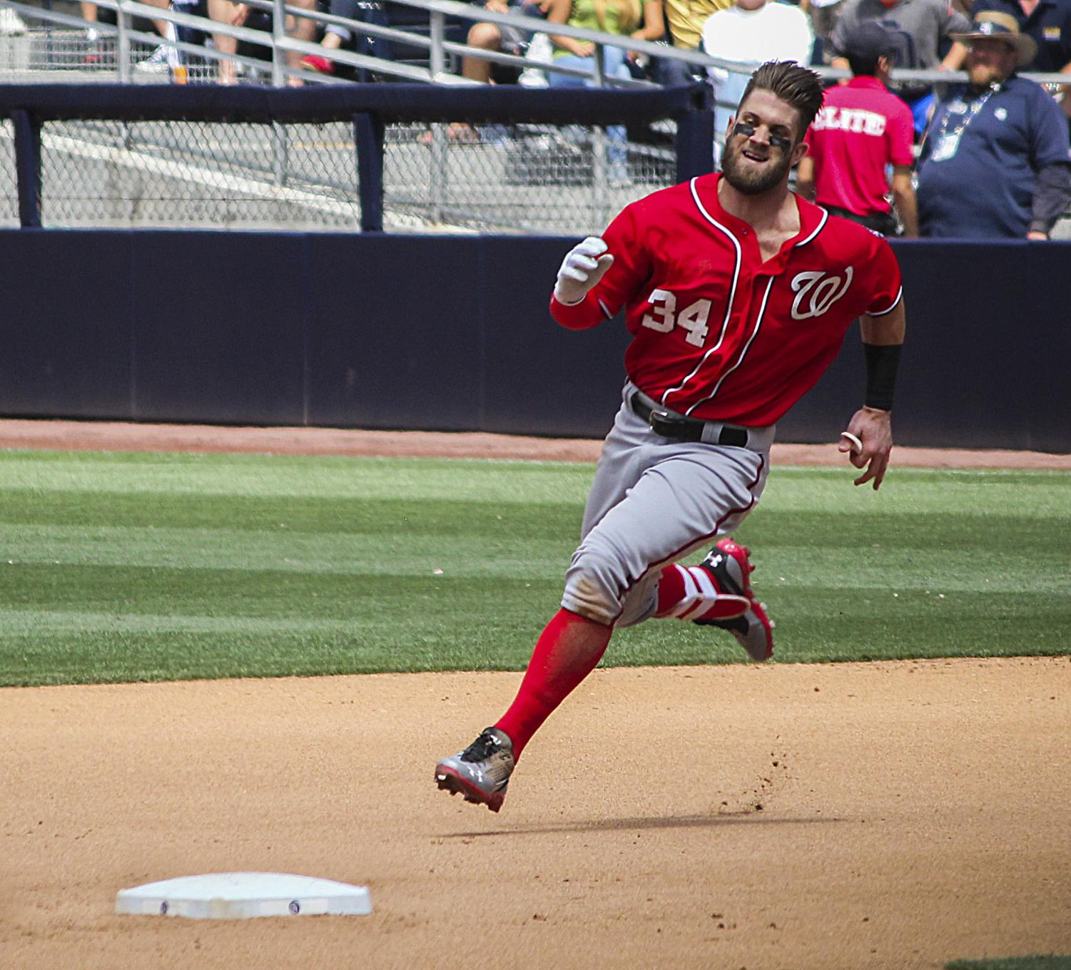 Nationals outfield star Bryce Harper sprints to a base. Harper was a free-agent this off-season, and there have been rumors that he will have offers from multiple teams.