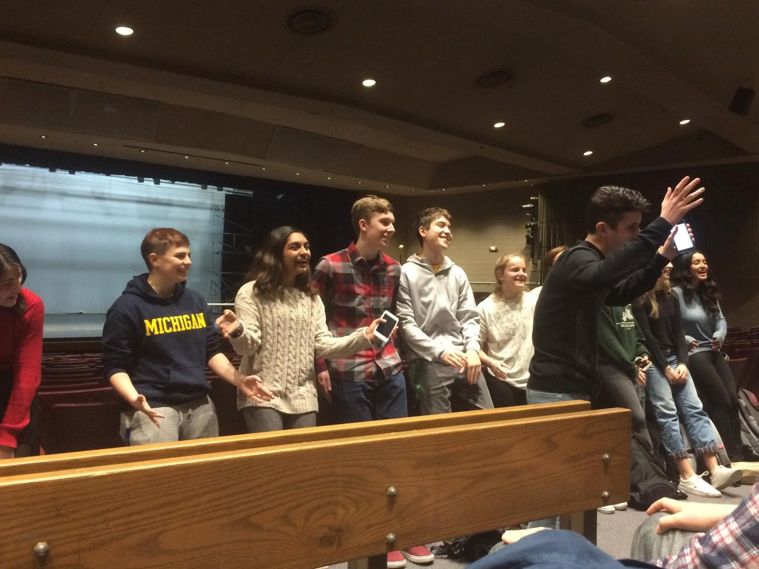 Senior Davis Gestiehr and the student directors of the talent show shout the theme of this year's show: