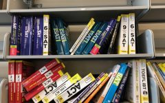 College test prep books sit on a shelf in the CIC.