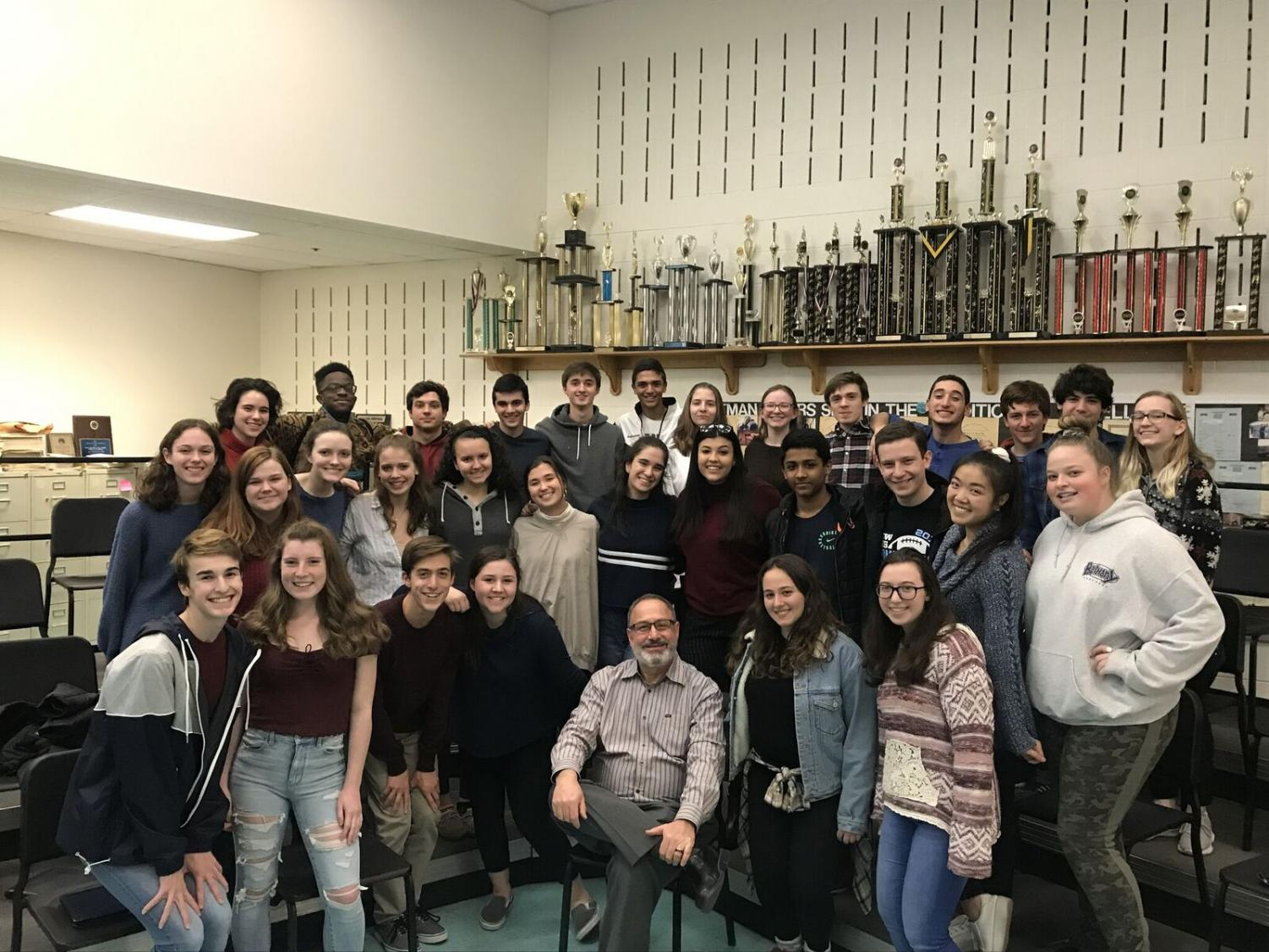 Chorus teacher Jeff Davidson poses with his students in chamber choir, an audition-based class. Davidson was chosen as one of six extraordinary educators by Bethesda Magazine.