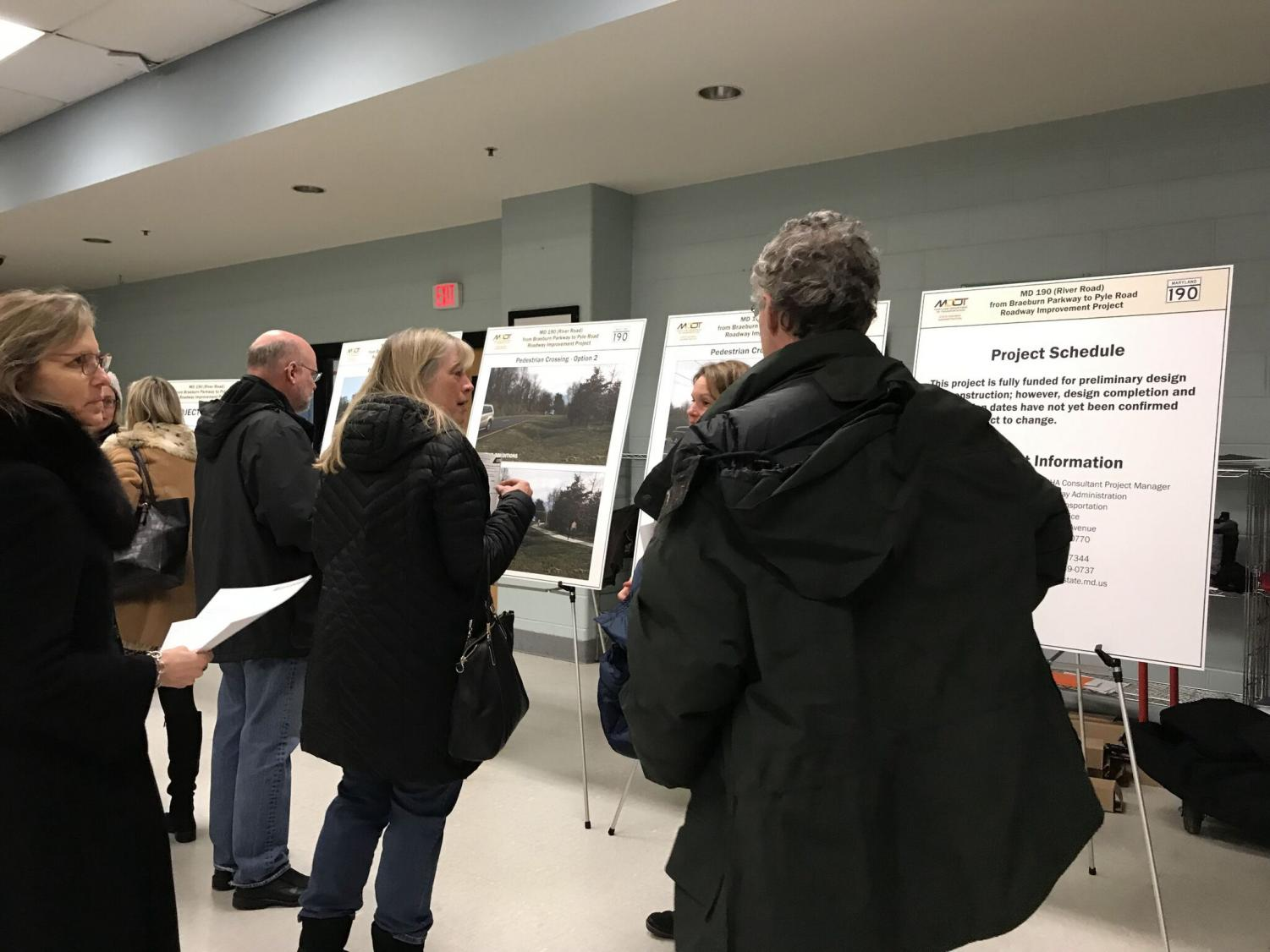 Community members discuss SHA proposals at a community meeting on Jan. 15 in the Pyle middle school cafeteria. An option will be decided on in the coming months and construction plans will be finalized at the end of the year. Photo by Anna Yuan.