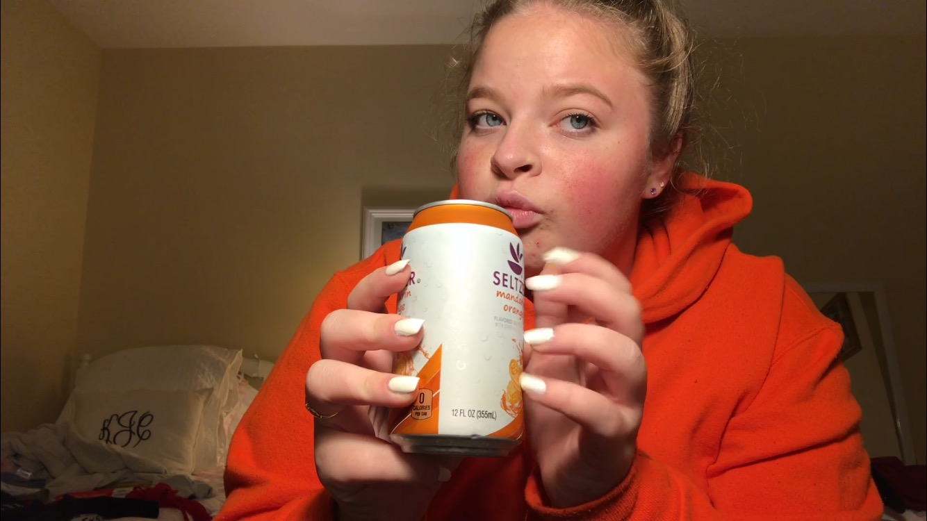 In a screenshot from her own video, senior Kiera Jevtich taps her nails on a soda can as part of an ASMR video. Jevtich makes ASMR videos and posts them on Instagram.