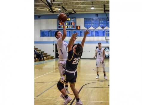 Boys basketball stunned by B–CC 62–61 on buzzer beater