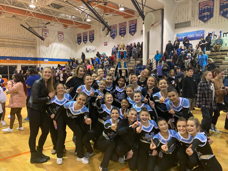 The+poms+celebrate+their+first+place+victory+at+the+Watkins+Mill+Poms+Invitational.+The+team+hopes+to+continue+their+success+in+future+competitions.+