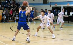 Boys basketball defeats Churchill 59–45 behind Jason Lewis' 23 points