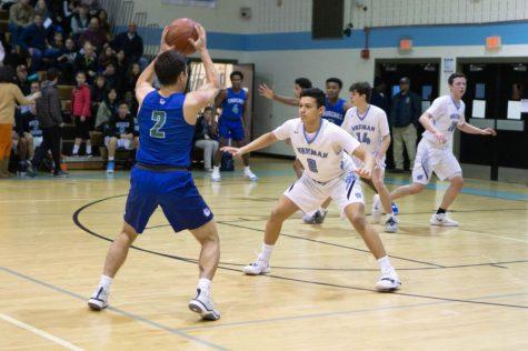 Boys basketball defeats Churchill 59–45 behind Jason Lewis' 23 points
