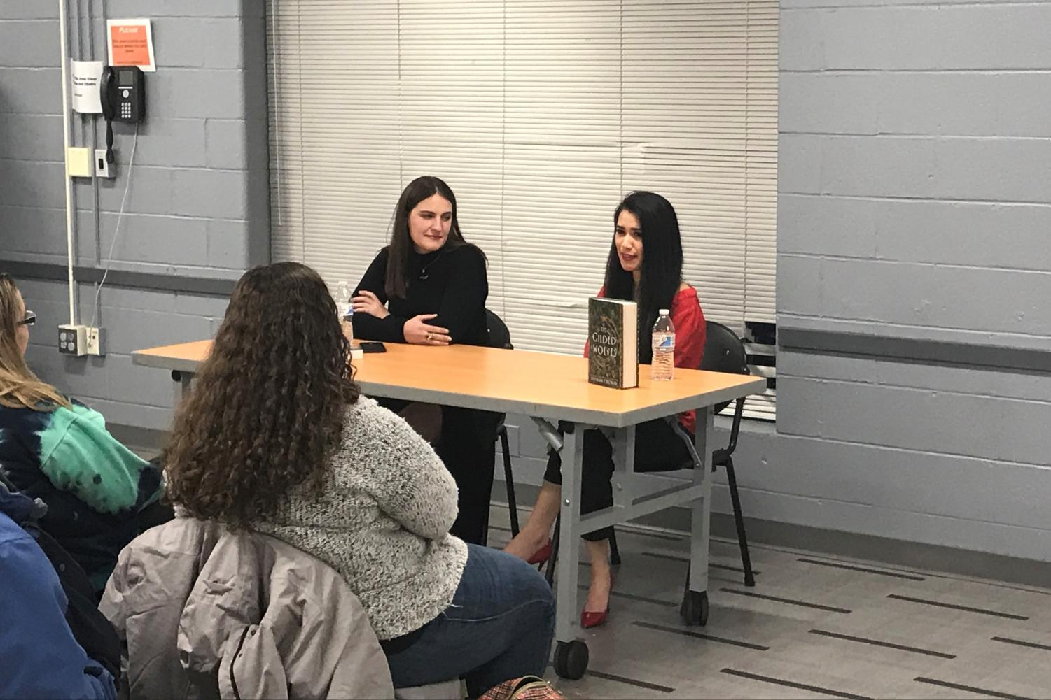 Authors Roshani Chokshi (right) and Sarah Lemon speak during a panel at Bethesda Library. The two talked about Chokshi's new book and gave advice for aspiring young writers.