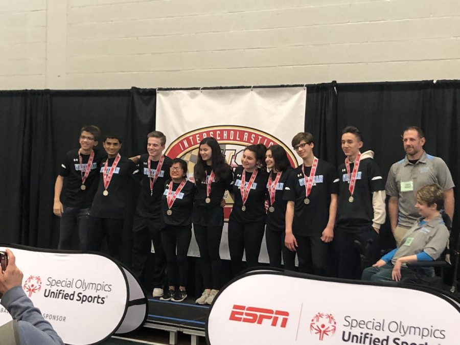 The+bocce+team+stands+on+the+podium+at+the+state+championship.+The+team+finished+second+in+their+division+at+states.+Photo+courtesy+Whitman+HS+Bocce+Fan+Club+Twitter.