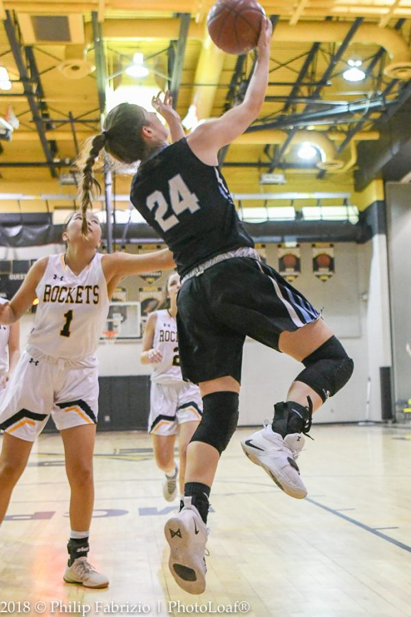 Guard Elyse Lowet attempts a reverse layup in the Vikes 54–40 win over Richard Montgomery Friday. The team heads into an important week nearing the end of the regular season.