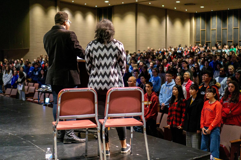Students rise as Black Student Union member  Reuben Pegues performs
