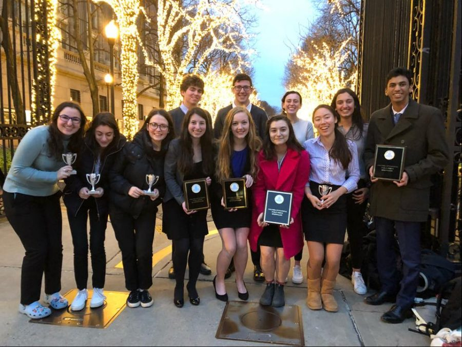 Public+forum+team+members+pose+with+their+awards+at+Columbia+University.+Two+teams+earned+bids+to+the+Gold+Tournament+of+Champions%2C+an+invitation-only+national+tournament+in+April.+Photo+courtesy+Hannah+Feuer.