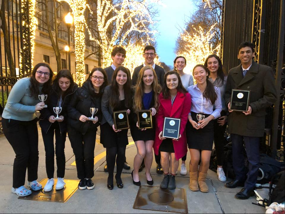 Public forum team members pose with their awards at Columbia University. Two teams earned bids to the Gold Tournament of Champions, an invitation-only national tournament in April. Photo courtesy Hannah Feuer.