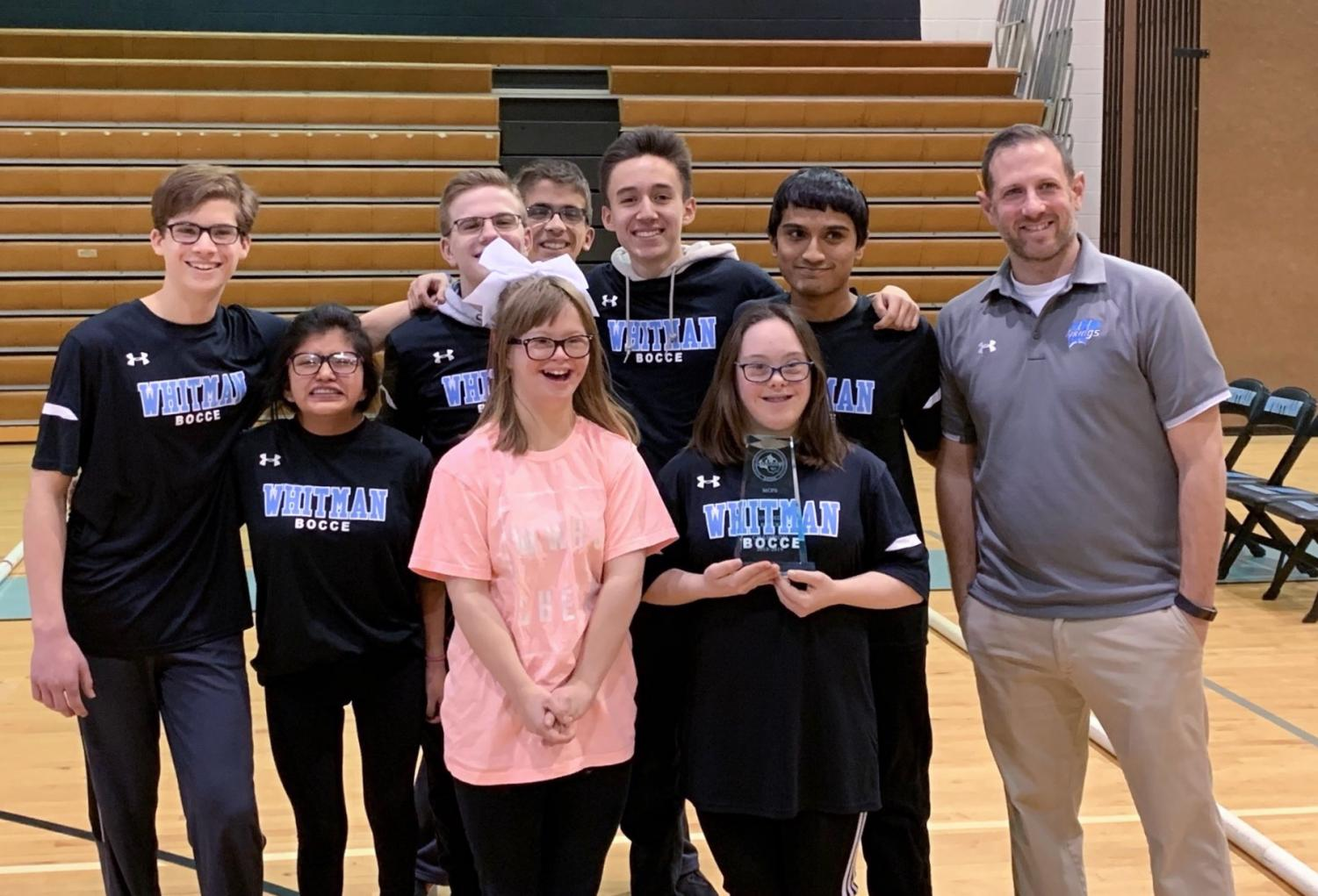 The bocce team poses with their trophy after winning the divisional championship last Saturday.  The win earned the team their second straight division title.