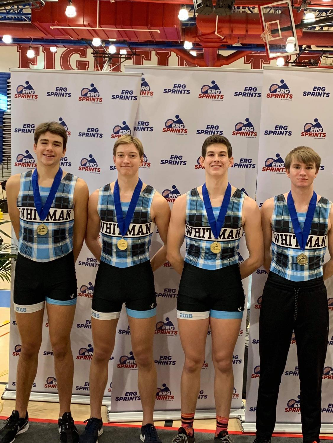 The quad slide team poses with their first place medals at the Erg Sprints competition. The team competes indoors in the winter while the river is frozen.