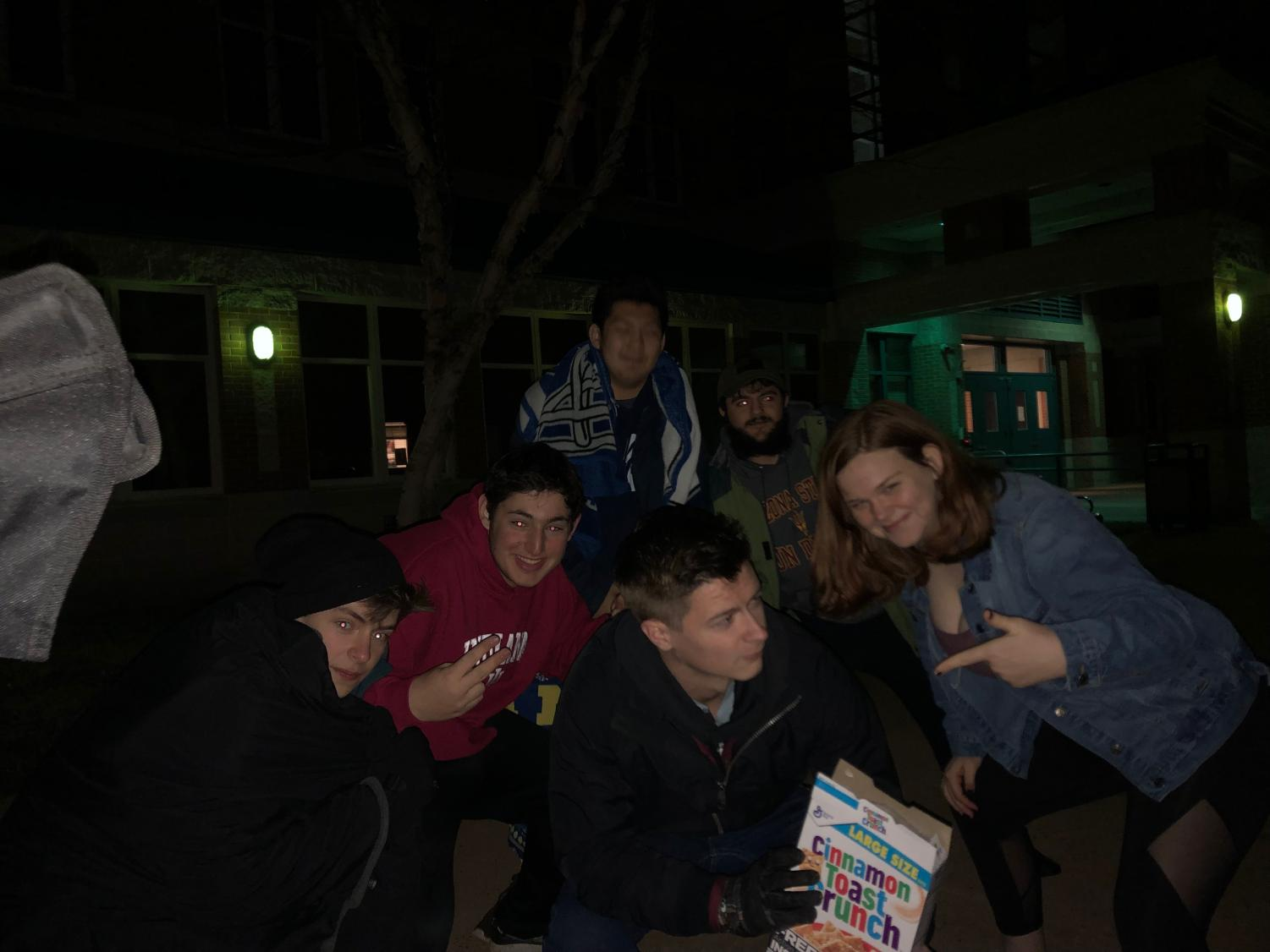 Students take part in a quick photoshoot while spending the night at Whitman. Around 50 students spent the night at Whitman in the hopes of receiving one of the four parking permits resold Wednesday morning.